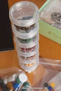 Board Game pieces in small plastic containers, Lock-Ups from The Container Store