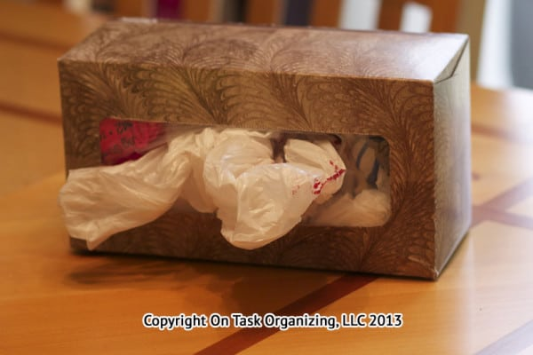Recycle a tissue box to store plastic bags.