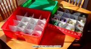 Organizing Holiday Decorations with plastic lidded bin with dividers